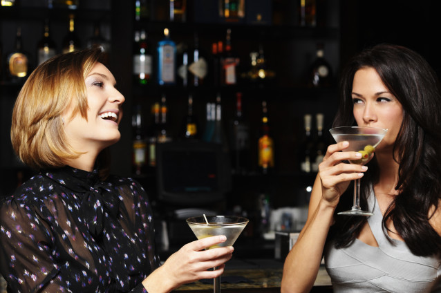 Two Young Women Drinking Martinis in Bar
